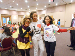 CSS dancer, Tina, shares a smile with the Temple Emmanuel mascot and teacher